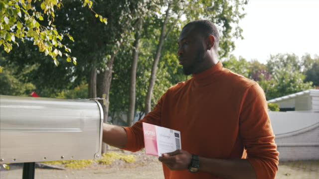 african-american man sending mail-in voting ballot during usa presidential election - letterbox stock videos & royalty-free footage
