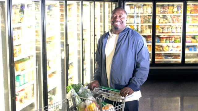 african-american man shopping for groceries - frozen food stock videos & royalty-free footage
