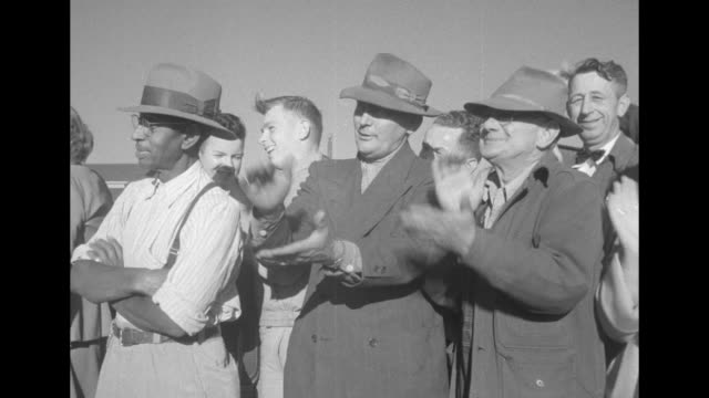 stockvideo's en b-roll-footage met africanamerican man stands with arms folded while white men around him applaud / pan photographers to president harry s truman daughter margaret... - margaret truman