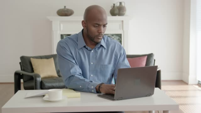 african-american man working from home office - using laptop stock videos & royalty-free footage