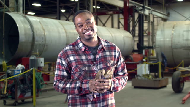 african-american man working in metal fabrication shop - plaid shirt stock videos & royalty-free footage