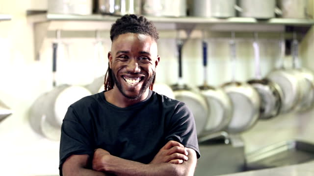 african-american man working in restaurant kitchen - caterer stock videos and b-roll footage