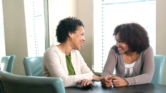 african-american mother and adult daughter talking - adult offspring stock videos & royalty-free footage