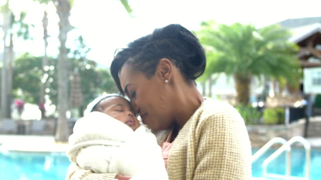 african-american mother with baby boy bundled in blanket - baby blanket stock videos & royalty-free footage