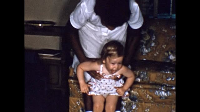 1956 african-american nanny playing with toddler - nanny stock videos & royalty-free footage