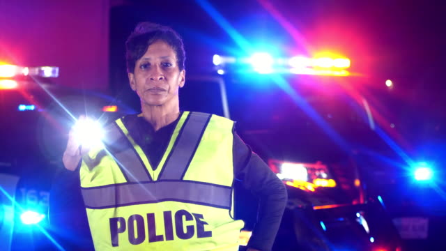 african-american policewoman searching with flashlight - police woman stock videos & royalty-free footage