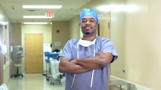 african-american surgeon in hospital corridor - protective workwear stock videos & royalty-free footage