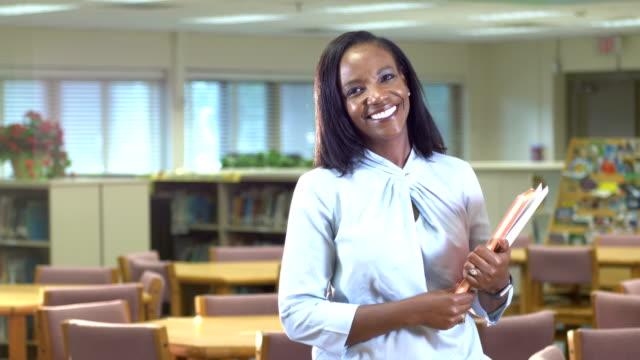 african-american teacher in school library - librarian stock videos & royalty-free footage