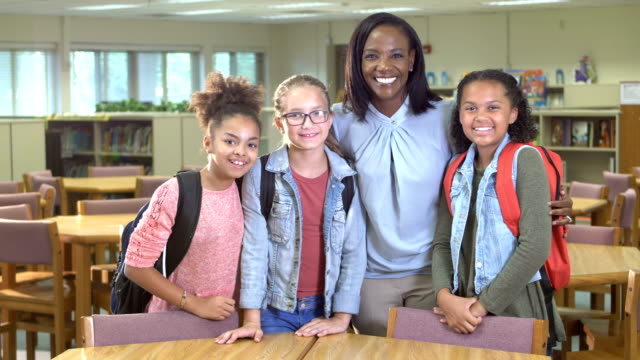 african-american teacher in school library with students - 10 11 years stock videos & royalty-free footage