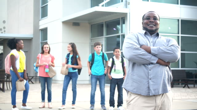 african-american teacher or parent outside middle school - junior high stock videos & royalty-free footage