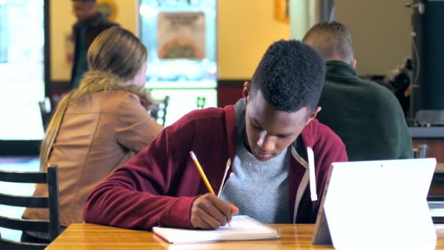 African-American teenage boy studying