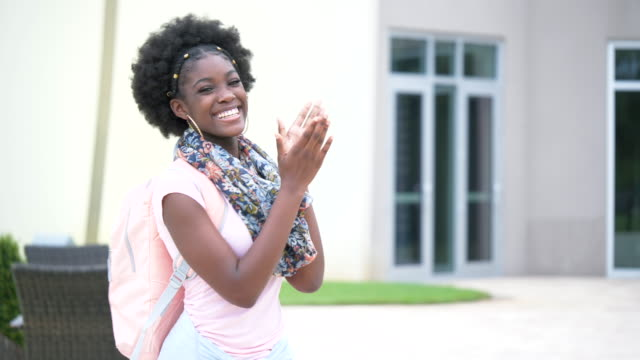 african-american teenage girl standing outside school - 16 17 years stock videos & royalty-free footage