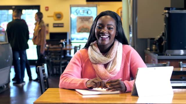 African-American teenage girl studying