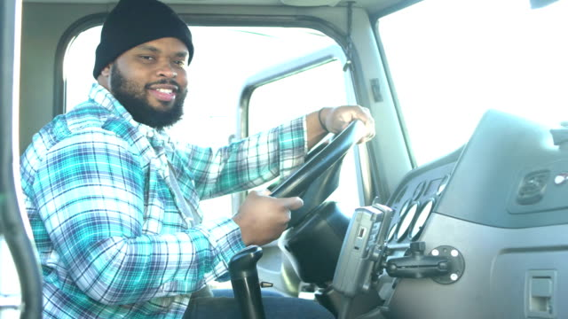 african-american truck driver, climbing into semi-truck - trucking stock videos & royalty-free footage