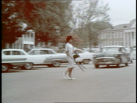 african-american vivian malone, reflecting a civil rights victory, crosses the street to enter a campus building at the university of alabama in 1963. - social movement stock videos & royalty-free footage