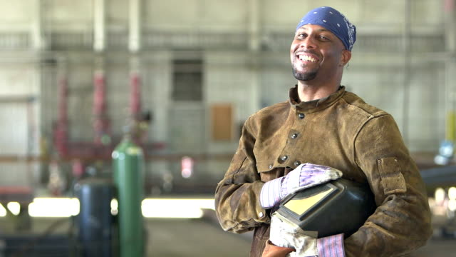 african-american welder in metal fabrication shop - welding stock videos & royalty-free footage