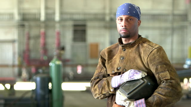 african-american welder in metal fabrication shop - construction worker stock videos and b-roll footage