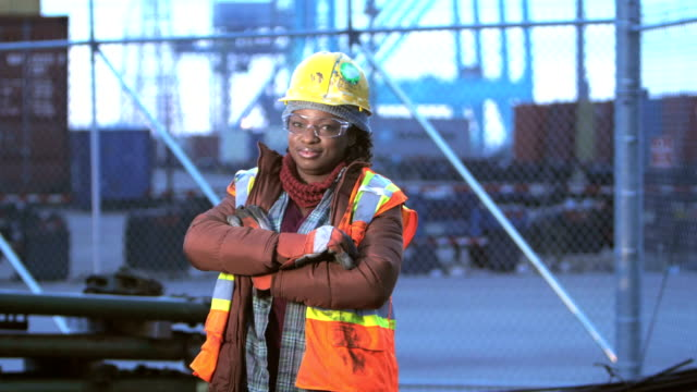 african-american woman at shipping port, arms crossed - females stock videos & royalty-free footage