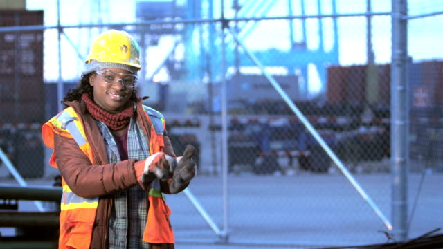 african-american woman at shipping port, work gloves - safety glasses stock videos & royalty-free footage