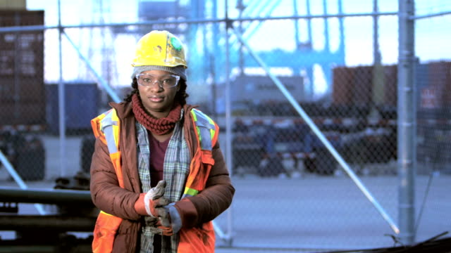 african-american woman at shipping port, work gloves - females stock videos & royalty-free footage