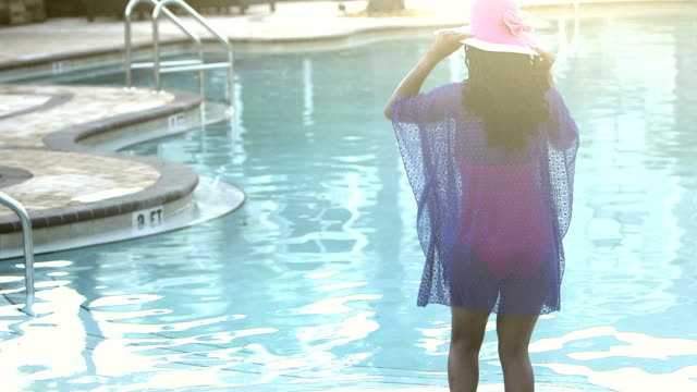 african-american woman dances in shallow end of pool - walking in water stock videos & royalty-free footage