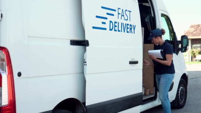 african-american woman delivering parcel - van stock videos & royalty-free footage