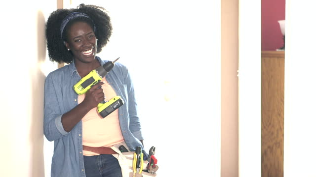 african-american woman doing home maintenance - tool belt stock videos and b-roll footage