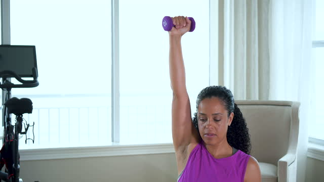african-american woman exercising at home, doing lunges - hand weight stock videos & royalty-free footage