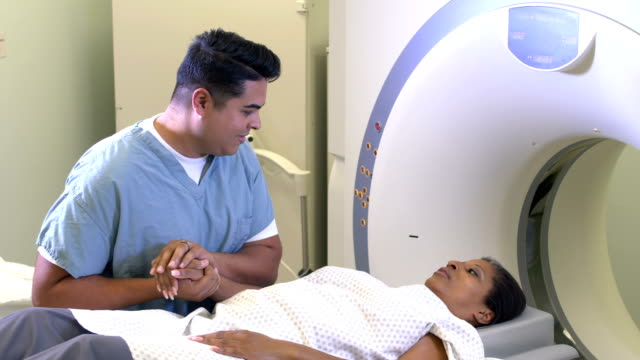 african-american woman getting a ct scan - radiographer stock videos & royalty-free footage