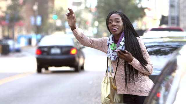 african-american woman hailing a taxi - braided hair stock videos & royalty-free footage