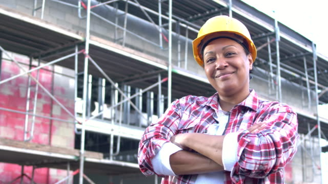 african-american woman in charge at construction site - plaid shirt stock videos & royalty-free footage