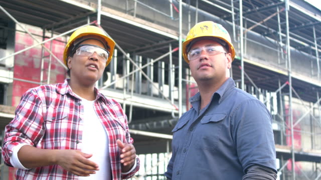 african-american woman in charge at construction site - role reversal stock videos & royalty-free footage