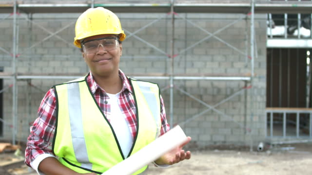 african-american woman in charge at construction site - approaching stock videos & royalty-free footage