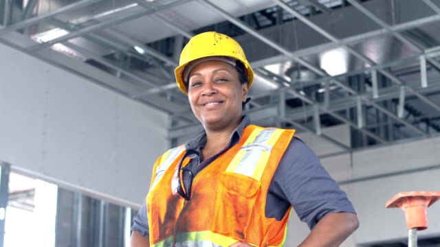 african-american woman in charge at construction site - african american ethnicity stock videos & royalty-free footage
