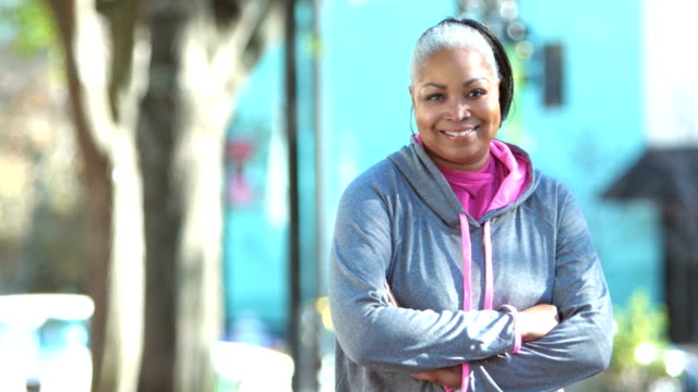african-american woman in sweatshirt, crossing arms - sportswear stock videos & royalty-free footage
