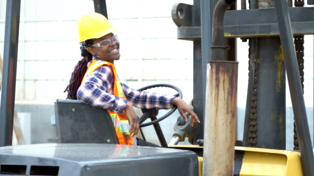 african-american woman operating forklift - construction worker stock videos & royalty-free footage