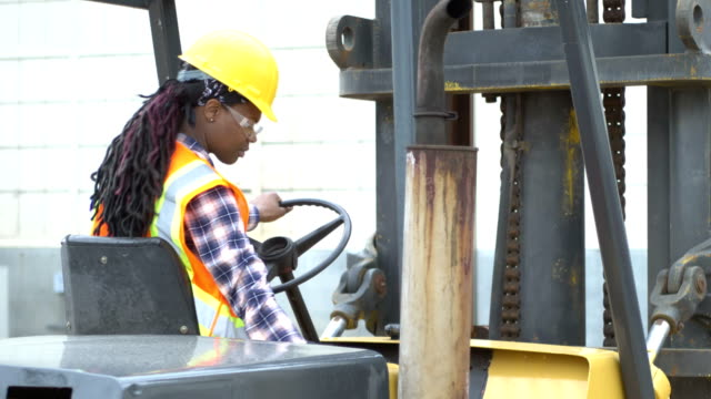 african-american woman operating forklift - forklift stock videos & royalty-free footage