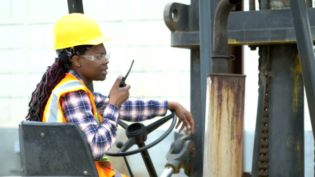 african-american woman operating forklift - african american ethnicity stock videos & royalty-free footage