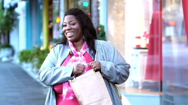 African-American woman shopping in the city