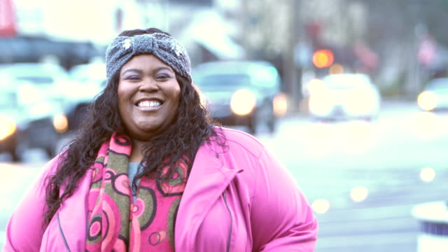african-american woman standing on city street - plus size model stock videos & royalty-free footage