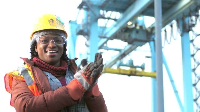 african-american woman working at seaport, smiling - potere femminile video stock e b–roll
