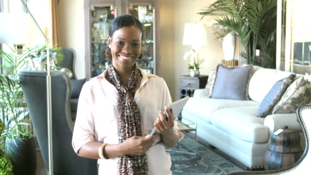 african-american woman working in a furniture store - showroom stock videos and b-roll footage