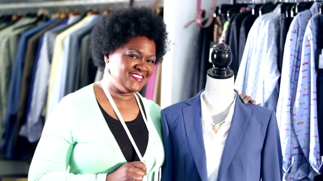 african-american woman working in clothing store - tape measure stock videos & royalty-free footage