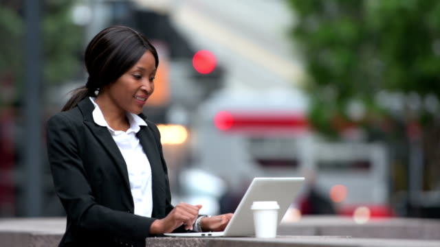 African-American woman working outdoors