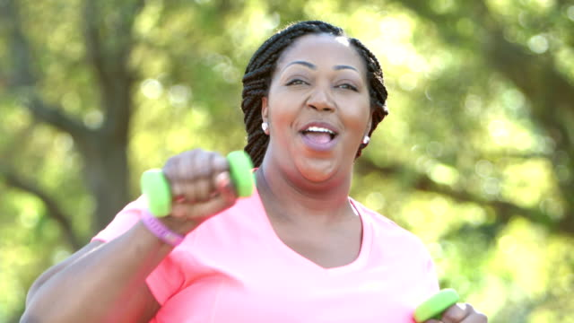 african-american women exercising, with hand weights - weight training stock videos & royalty-free footage