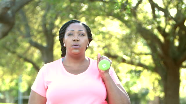 african-american women exercising, with hand weights - overweight active stock videos & royalty-free footage