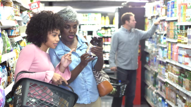 african-american women talking in supermarket - nutrition label stock videos and b-roll footage
