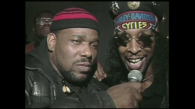 afrika bambatta & bootsy collins interviewed by dj chuck chillout backstage at the zulu nation 20th anniversary at the building in nyc 1994. - anno 1994 video stock e b–roll