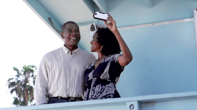 Afro American Couple Photographing