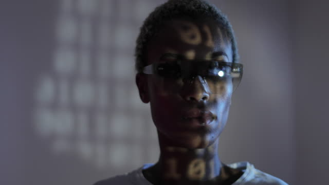 afro american female programmer with smart glasses looking at coding - erweiterte realität stock-videos und b-roll-filmmaterial